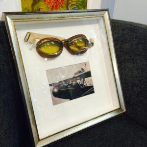 custom framing for unique items like this aviator memorabilia from a Memphis-based frame shop