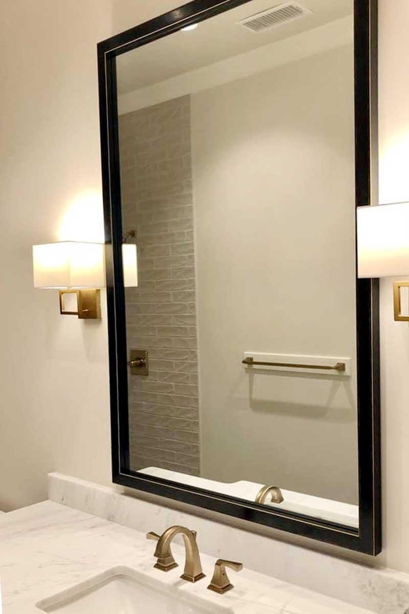 custom mirrors like this can enhance a bathroom