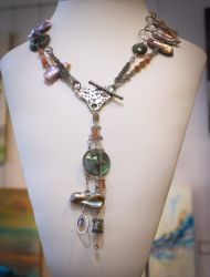 Necklace includes an artisan collection of stones showcased with fine silver | $450