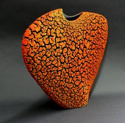 color shifts on Envelope Vase from dark red-orange